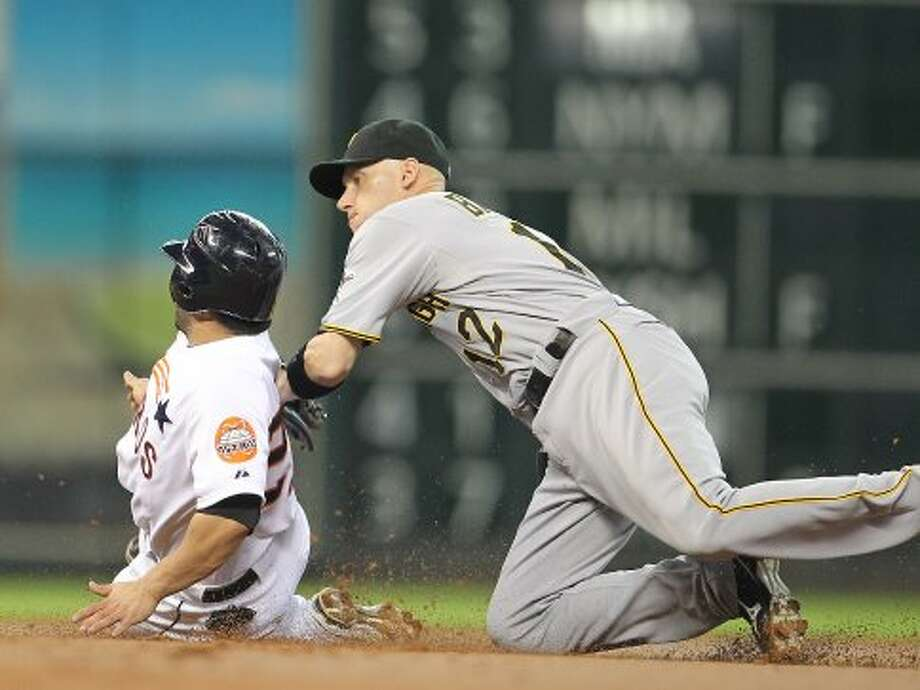 Houston Astros second baseman Jose Altuve (27) is tagged out by Pittsburgh Pirates shortstop Clint Barmes (12) as he was caught stealing second during the first inning of an MLB baseball game at Minute Maid Park on Saturday, Sept. 22, 2012, in Houston.  ( Karen Warren / Houston Chronicle ) (Houston Chronicle)