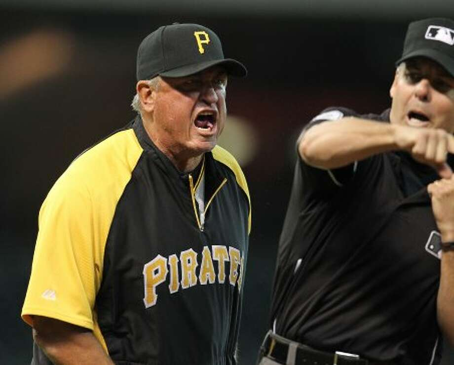 Pittsburgh Pirates manager Clint Hurdle (13) gets ejected by first base umpire Tim Timmons over a changed call at first involvingPittsburgh Pirates catcher Michael McKenry (55) during the second inning of an MLB baseball game at Minute Maid Park on Saturday, Sept. 22, 2012, in Houston.  ( Karen Warren / Houston Chronicle ) (Houston Chronicle)