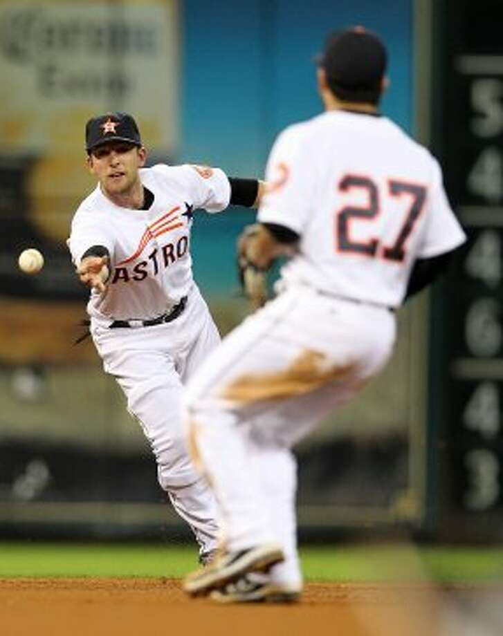 Houston Astros shortstop Jed Lowrie (4) passes the force out ball hit by Pittsburgh Pirates catcher Michael McKenry (55) to Houston Astros second baseman Jose Altuve (27) during the fourth inning of an MLB baseball game at Minute Maid Park on Saturday, Sept. 22, 2012, in Houston.  ( Karen Warren / Houston Chronicle ) (Houston Chronicle)