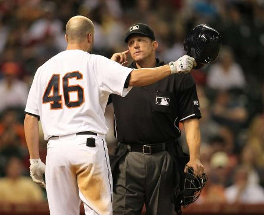 Houston Astros third baseman Scott Moore (46) argues with home plate umpire Jeff Kellogg after he was called out on a strike during the fifth inning of an MLB baseball game at Minute Maid Park on Saturday, Sept. 22, 2012, in Houston.  ( Karen Warren / Houston Chronicle ) (Houston Chronicle)
