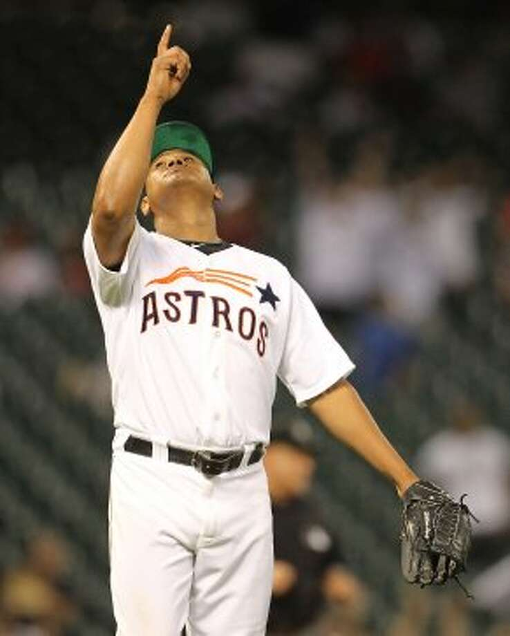 Houston Astros relief pitcher Wilton Lopez (59) reacts after Pittsburgh Pirates first baseman Garrett Jones (46) flied out to Houston Astros center fielder Brandon Barnes (39) to end the game during the ninth inning of an MLB baseball game at Minute Maid Park on Saturday, Sept. 22, 2012, in Houston. Astros won the game 4-1.   ( Karen Warren / Houston Chronicle ) (Houston Chronicle)