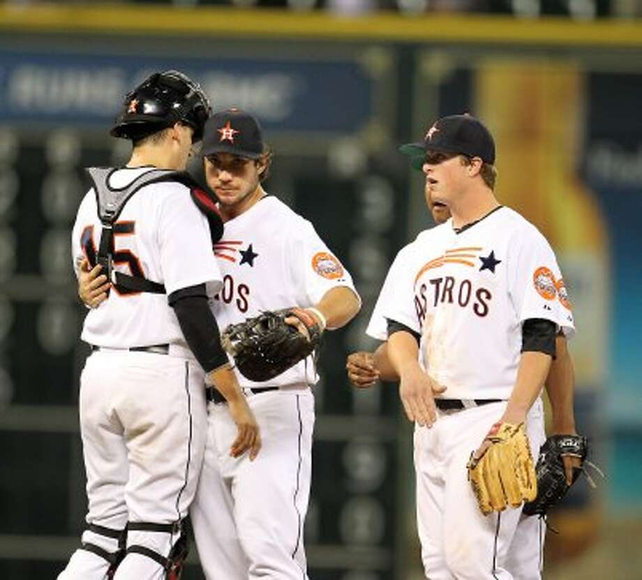 Houston Astros first baseman Brett Wallace (29) hugs Houston Astros catcher Jason Castro (15) after the Astros win during an MLB baseball game at Minute Maid Park on Saturday, Sept. 22, 2012, in Houston. Astros won the game 4-1.   ( Karen Warren / Houston Chronicle ) (Houston Chronicle)