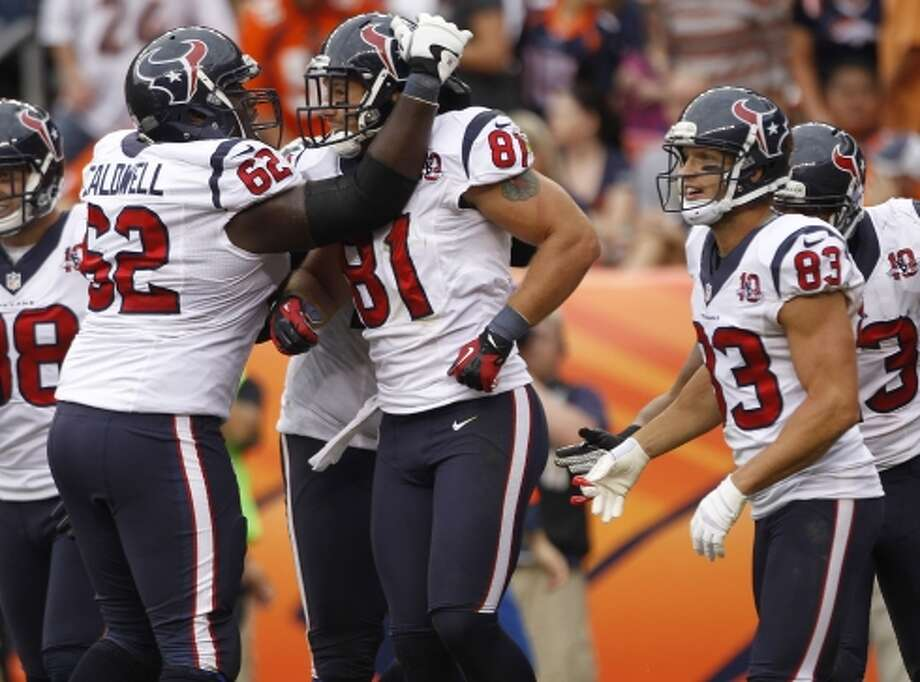 Texans guard Antoine Caldwell, tight end Owen Daniels and wide receiver Kevin Walter celebrate Daniels' 14-yard touchdown reception. (Brett Coomer / © 2012  Houston Chronicle)