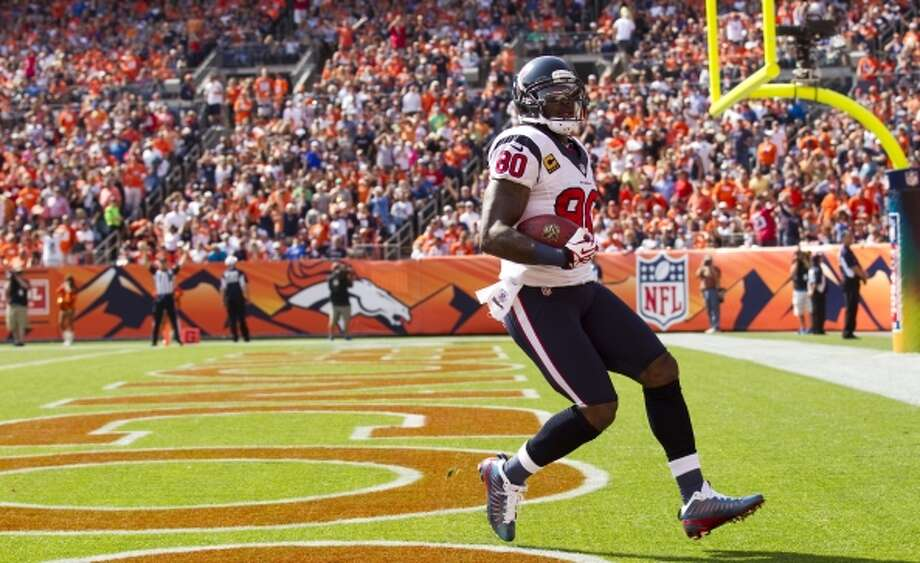 Texans wide receiver Andre Johnson  runs into the end zone after his 60-yard touchdown reception. (Brett Coomer / © 2012  Houston Chronicle)