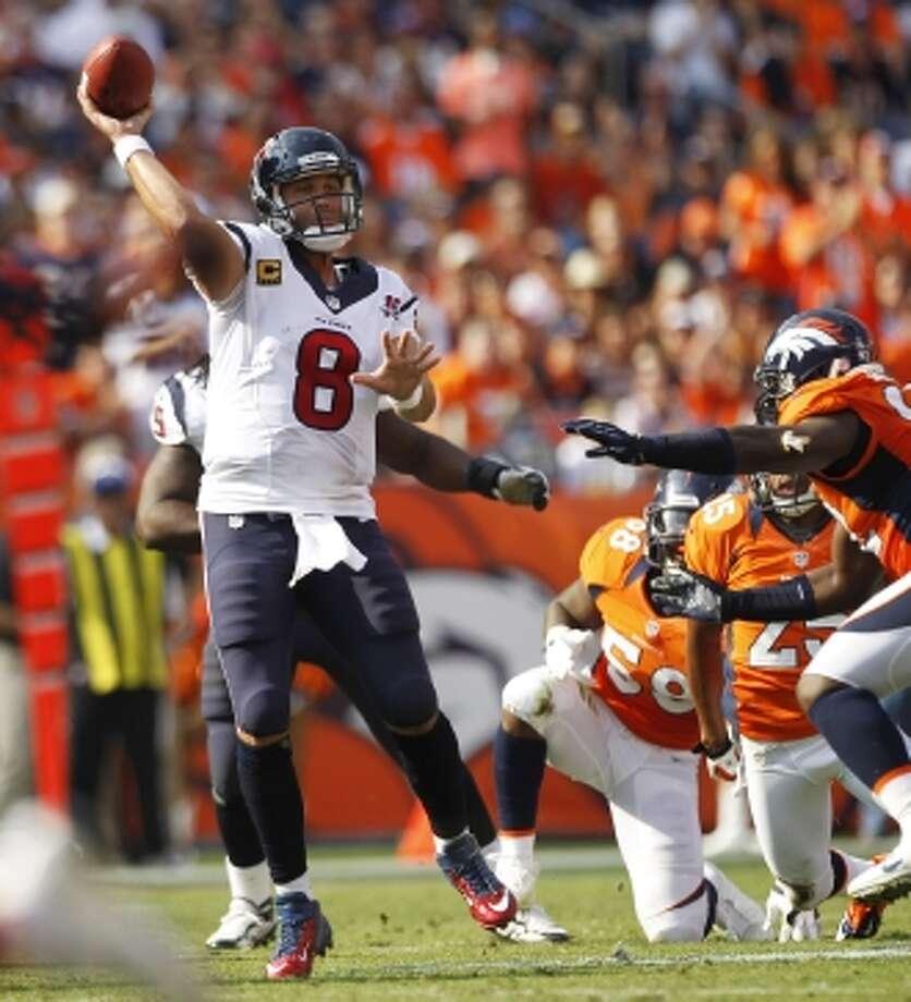 Texans quarterback Matt Schaub throws a pass against the Broncos defense during the second quarter. (Brett Coomer / © 2012  Houston Chronicle)