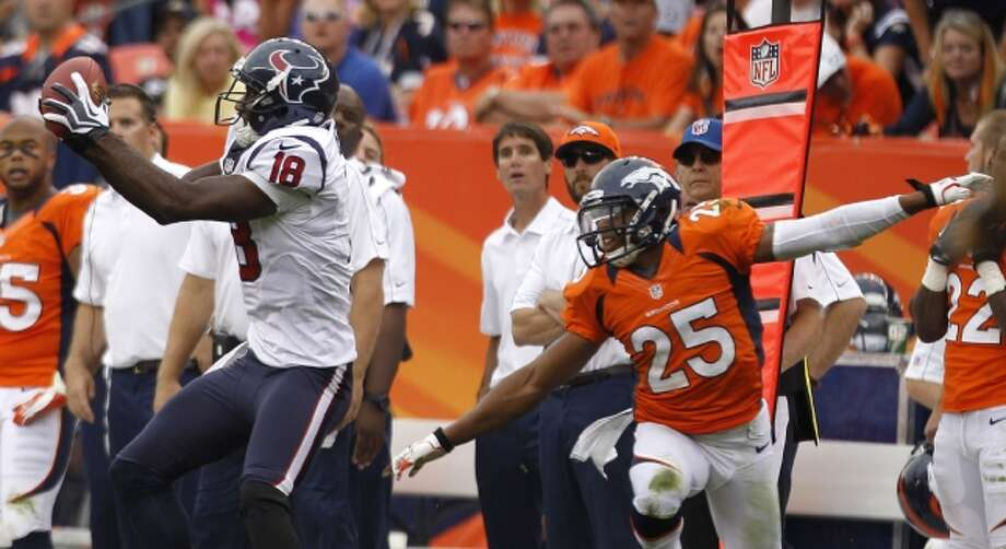 Texans wide receiver Lestar Jean makes a catch in front of Denver Broncos strong safety Chris Harris. (Brett Coomer / © 2012  Houston Chronicle)