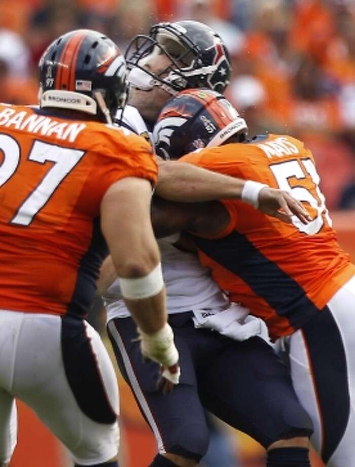 Texans quarterback Matt Schaub took a big - and possibly illegal - hit in the third quarter. (Brett Coomer / © 2012  Houston Chronicle)