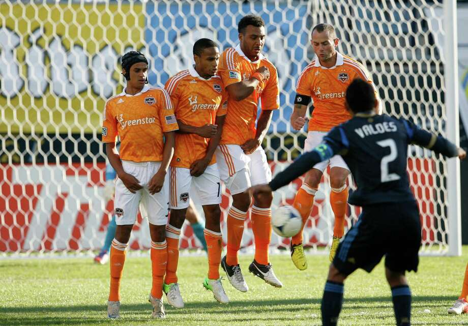 Players in the Dynamo's wall thwart a free kick by the Union's Carlos Valdes. Photo: Chris Gardner / 2012 Getty Images