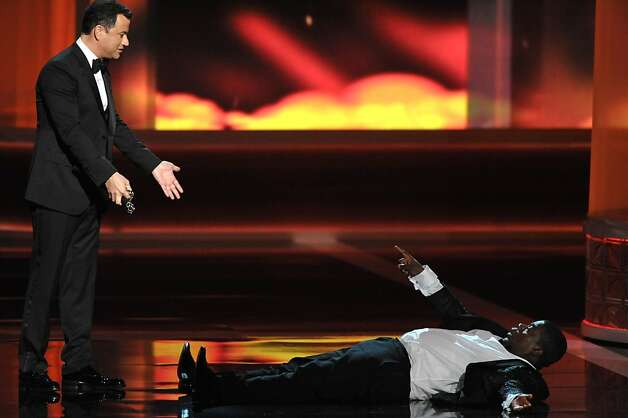 Host Jimmy Kimmel, left, and Tracy Morgan perform onstage at the 64th Primetime Emmy Awards at the Nokia Theatre on Sunday, Sept. 23, 2012, in Los Angeles. (Photo by John Shearer/Invision/AP) Photo: John Shearer, Associated Press
