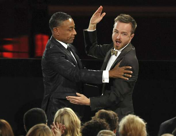 "Giancarlo Esposito, left, congratulates Aaron Paul after Paul won the award for outstanding supporting actor in a drama series for ""Breaking Bad"" at the 64th Primetime Emmy Awards at the Nokia Theatre on Sunday, Sept. 23, 2012, in Los Angeles. (Photo by John Shearer/Invision/AP) Photo: John Shearer, Associated Press"