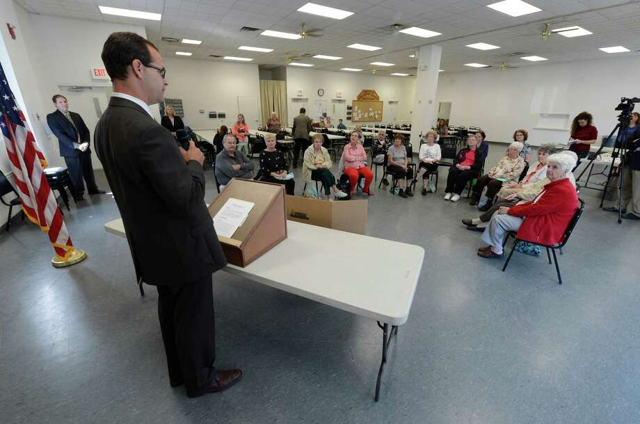 Acting Director of the State Office for the Aging Greg Olsen spoke to members of the Rotterdam Senior Citizens about the prevention of falls at a gathering at the Rotterdam Senior Center in Rotterdam, N.Y.  Sept. 21, 2012. (Skip Dickstein/Times Union) Photo: Skip Dickstein / 00019374A