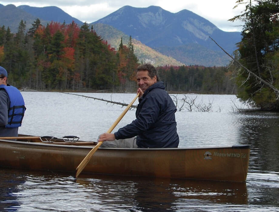 Gov. Andrew Cuomo canoes Sunday afternoon across Boreas Pond in the shadow of the Adirondack High Peaks. (Jimmy Vielkind/Times Union)