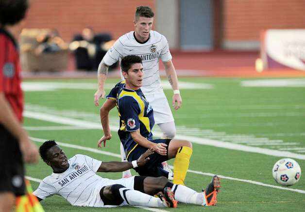 Minnesota Stars' Kevin Venegas, center, fights San Antonio Scorpions' Walter Ramirez, left, and Wes Knight for the ball during the first half of an NASL soccer game, Sunday, Sept. 23, 2012, at Heroes Stadium in San Antonio. San Antonio and Minnesota tied 1-1. Photo: Darren Abate, Express-News