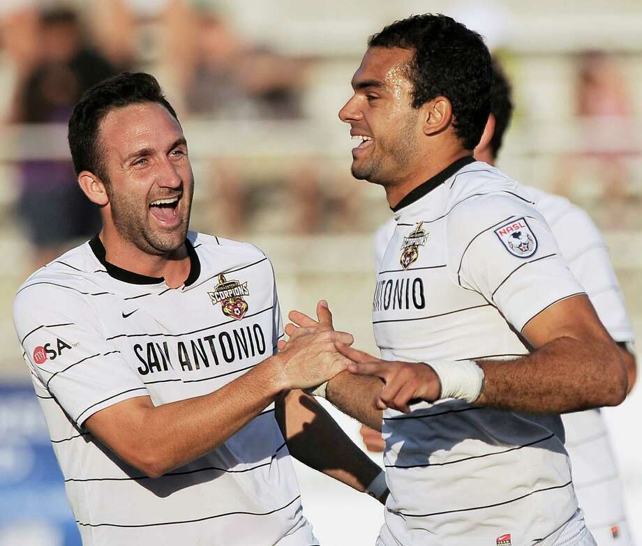 San Antonio Scorpions' Pablo Campos, right, celebrates a goal with teammate Ryan Cochrane during the first half of an NASL soccer game against the Minnesota Stars FC, Sunday, Sept. 23, 2012, at Heroes Stadium in San Antonio. Photo: Darren Abate, Express-News