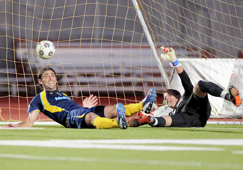 Minnesota Stars' Kevin Friedland, left, celebrates a Stars goal after colliding with San Antonio Scorpions goalkeeper Daryl Sattler in the net during an NASL soccer game, Sunday, Sept. 23, 2012, at Heroes Stadium in San Antonio. San Antonio and Minnesota tied 1-1. Photo: Darren Abate, Express-News