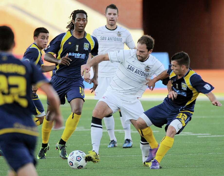 San Antonio Scorpions' Kevin Harmse, middle right, beats Minnesota Stars' Lucas Rodriguez, right, and Amani Walker to the ball during an NASL soccer game, Sunday, Sept. 23, 2012, at Heroes Stadium in San Antonio. San Antonio and Minnesota tied 1-1. Photo: Darren Abate, Express-News