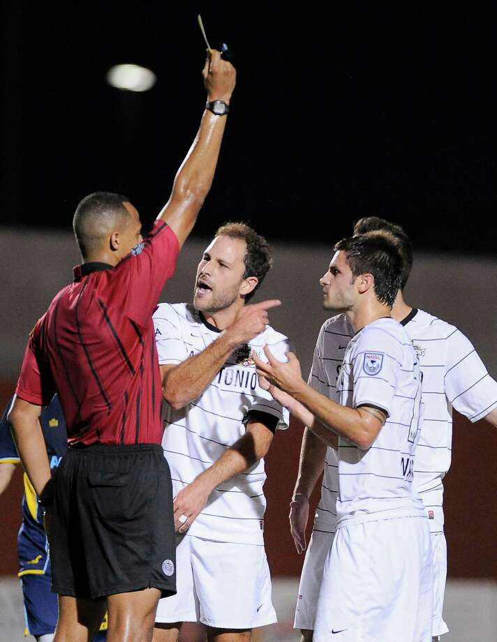 San Antonio Scorpions captain Kevin Harmse, middle, argues a call with the referee during an NASL soccer game against the Minnesota Stars FC, Sunday, Sept. 23, 2012, at Heroes Stadium in San Antonio. San Antonio and Minnesota tied 1-1. Photo: Darren Abate, Express-News