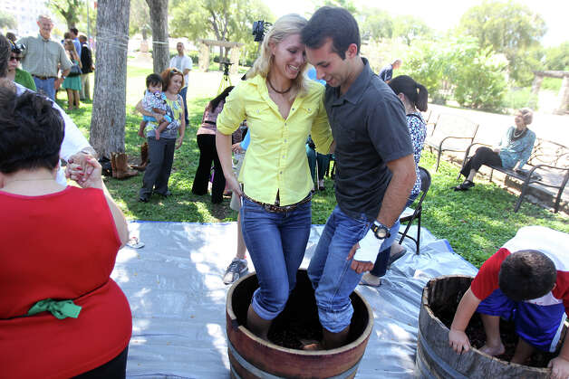 Engaged couple MichelleVan Hecke and Will Gonzabia, whose parents and grandparents were married in the same church, stomp grapes during the 85th annual La Vendemmia Celebration at San Francesco di Paolo Catholic Church, September 23, 2012. Photo: JENNIFER WHITNEY / © Jennifer Whitney