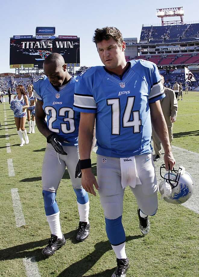 Detroit Lions quarterback Shaun Hill (14) and cornerback Chris Houston (23) leave the field after losing to the Tennessee Titans 44-41 in overtime at an NFL football game on Sunday, Sept. 23, 2012, in Nashville, Tenn. (AP Photo/Wade Payne) Photo: Wade Payne, Associated Press