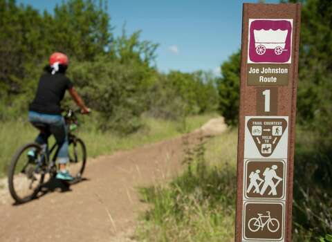 A cyclist rides on the Joe Johnston trail route, Sunday, Sept. 23, 2012, at the Government Canyon State Natural Area in San Antonio. Photo: Darren Abate, Darren Abate/For The Express-New