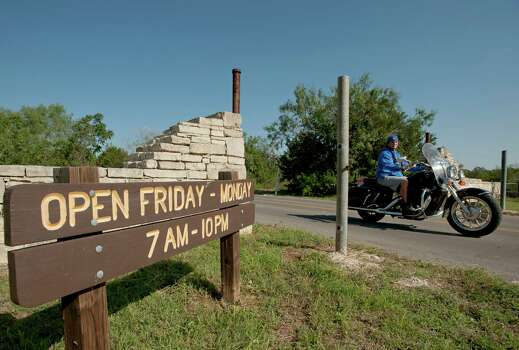 A motorcyclist rides out of the park's main entrance, Sunday, Sept. 23, 2012, at the Government Canyon State Natural Area in San Antonio. Photo: Darren Abate, Darren Abate/For The Express-New