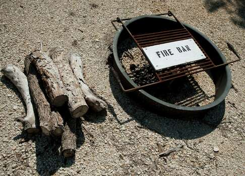 A campsite fire pit, photographed Sunday, Sept. 23, 2012, at the Government Canyon State Natural Area in San Antonio. Photo: Darren Abate, Darren Abate/For The Express-New