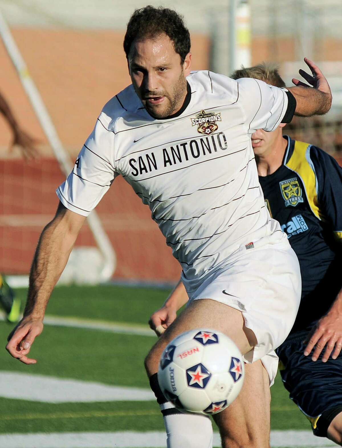 San Antonio Scorpions captain Kevin Harmse takes control of the ball ahead of Minnesota Stars' Nate Polak during an NASL soccer game, Sunday, Sept. 23, 2012, at Heroes Stadium in San Antonio. San Antonio and Minnesota tied 1-1.