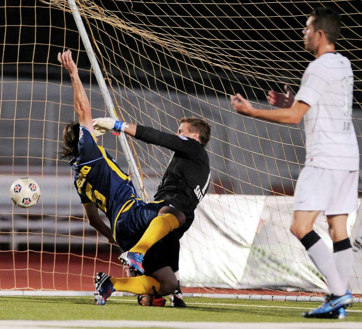 Minnesota Stars' Kevin Friedland, left, collides with San Antonio Scorpions goalkeeper Daryl Sattler, which resulted in a Minnesota goal in the second half of an NASL soccer game, Sunday, Sept. 23, 2012, at Heroes Stadium in San Antonio. San Antonio and Minnesota tied 1-1.
