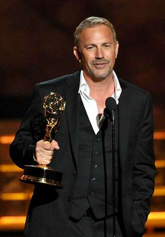 "Kevin Costner accepts the award for outstanding lead actor in a miniseries or movie for ""Hatfields & McCoys"" at the 64th Primetime Emmy Awards at the Nokia Theatre on Sunday, Sept. 23, 2012, in Los Angeles. (Photo by John Shearer/Invision/AP) Photo: John Shearer, Associated Press"
