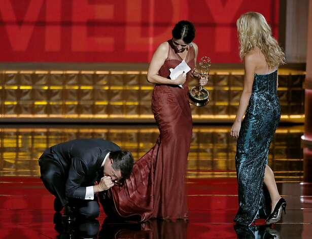 Steven Colbert kisses the hem of Julia Louis-Dreyfus dress on stage at the 64th Annual Primetime Emmy Awards on Sunday, September 23, 2011, at Nokia Theatre, L.A. Live, in Los Angeles, California. (Mark Boster/Los Angeles Times/MCT) Photo: Mark Boster, McClatchy-Tribune News Service