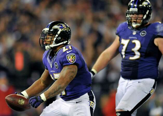 Ravens running back Ray Rice (left) celebrates after scoring a touchdown in front of teammate Marshal Yanda against the Patriots in Baltimore, Sept. 23, 2012. Baltimore has won 21 of its last 22 at home. (AP Photo/Gail Burton) Photo: Gail Burton, Associated Press / FR4095 AP