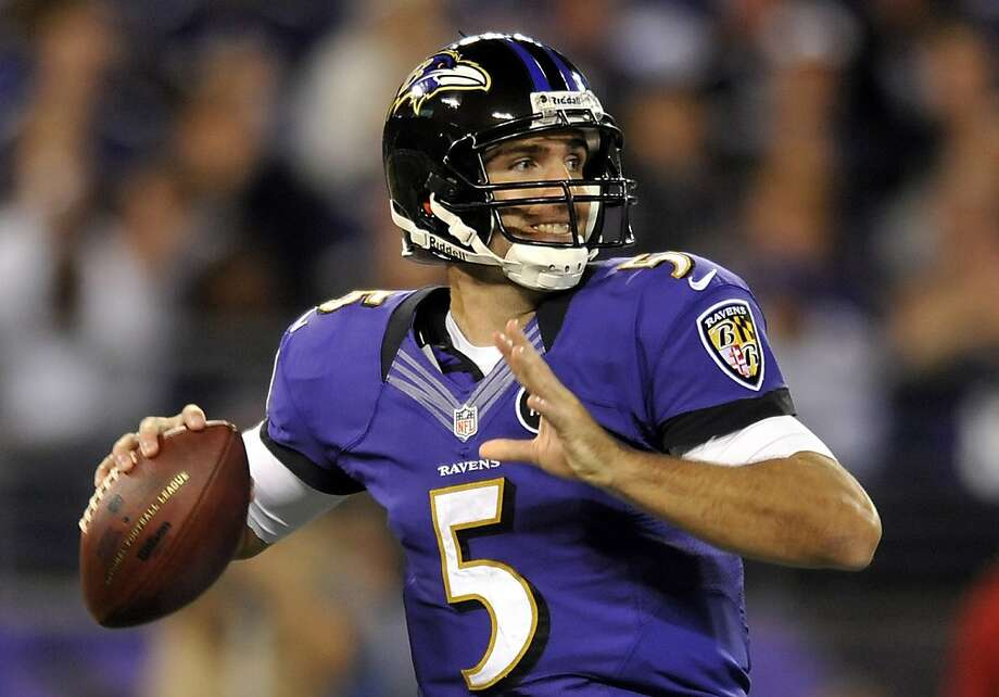 Joe Flacco threw for 382 yards and three touchdowns but needed a pass interference call to set up the winning kick. Photo: Gail Burton, Associated Press