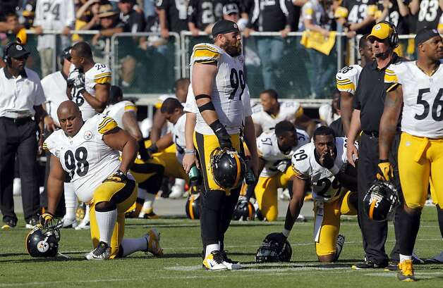 Steelers players take a moment as Darrius Heyward-Bey is tended to by medical personnel after a hit in the end zone. Heyward-Bey was taken from the field on a backboard. The Oakland Raiders played the Pittsburgh Steelers at O.co Coliseum in Oakland, Calif., on Sunday, September 23, 2012, and defeated the Steelers 34-31. Photo: Carlos Avila Gonzalez - San Fran, The Chronicle