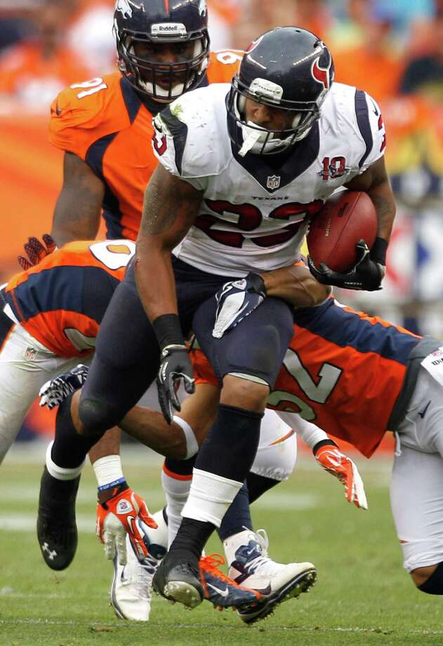 Arian Foster (23) was the workhorse on Sunday, making would-be Broncos tacklers miss to the tune of 105 yards rushing on 25 carries. He also caught a 3-yard TD pass. Photo: Brett Coomer / © 2012  Houston Chronicle
