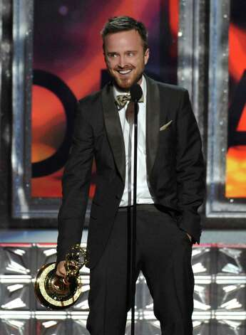 "Aaron Paul accepts the award for Outstanding Supporting Actor in a Drama Series for ""Breaking Bad"" at the 64th Primetime Emmy Awards at the Nokia Theatre on Sunday, Sept. 23, 2012, in Los Angeles. (Photo by John Shearer/Invision/AP) Photo: John Shearer, INVL / Invision"