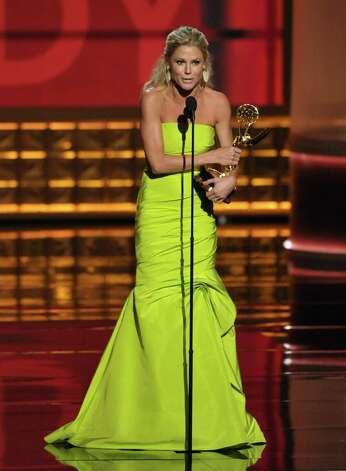 "Julie Bowen accepts the award for outstanding supporting actress in a comedy series for ""Modern Family"" at the 64th Primetime Emmy Awards at the Nokia Theatre on Sunday, Sept. 23, 2012, in Los Angeles. (Photo by John Shearer/Invision/AP) Photo: John Shearer, INVL / Invision"