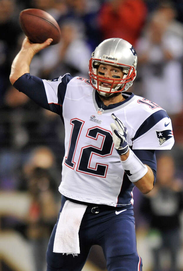 New England Patriots quarterback Tom Brady throws to a receiver in the first half of an NFL football game against the Baltimore Ravens in Baltimore, Sunday, Sept. 23, 2012. (AP Photo/Gail Burton) Photo: Gail Burton