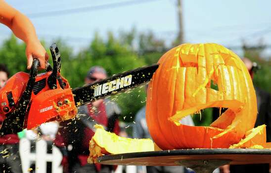 """""""Princess Pumpkin"""" starts to put the finishing touches on her carving. Photo: LINDSEY WASSON / SEATTLEPI.COM"""