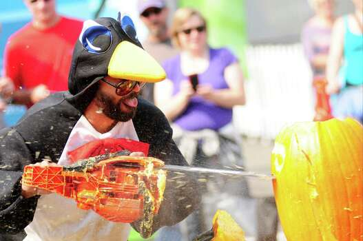 """Rob Beck, or """"Chilly Willis,"""" sticks his tongue out as he carves. Photo: LINDSEY WASSON / SEATTLEPI.COM"""