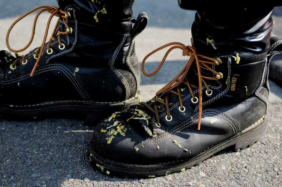 Contestant Whitebeard's boots are covered in pumpkin debris. Photo: LINDSEY WASSON / SEATTLEPI.COM