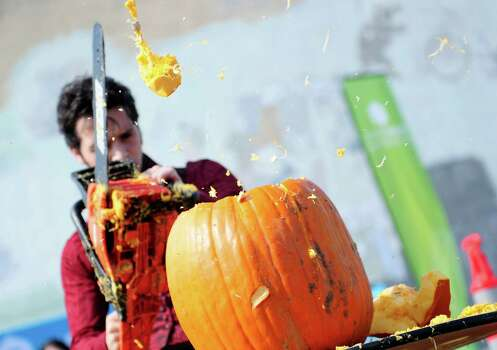 """""""Ian the Reasonably Alright"""" sends a large chunk of pumpkin flying as he competes. Photo: LINDSEY WASSON / SEATTLEPI.COM"""