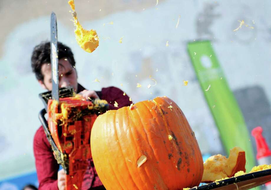 """Ian the Reasonably Alright"" sends a large chunk of pumpkin flying as he competes. Photo: LINDSEY WASSON / SEATTLEPI.COM"