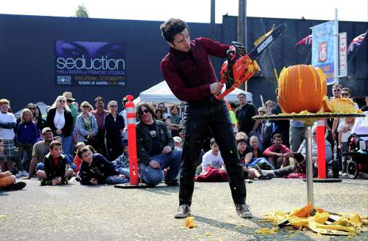 """The crowd looks on as """"Ian the Reasonably Alright"""" shreds his pumpkin. Photo: LINDSEY WASSON / SEATTLEPI.COM"""