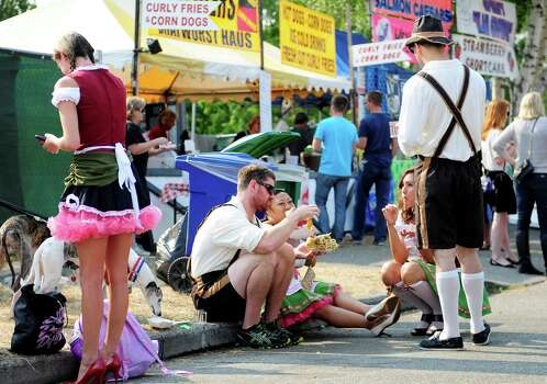 People in Bavarian-themed dress enjoy some lunch. Photo: LINDSEY WASSON / SEATTLEPI.COM