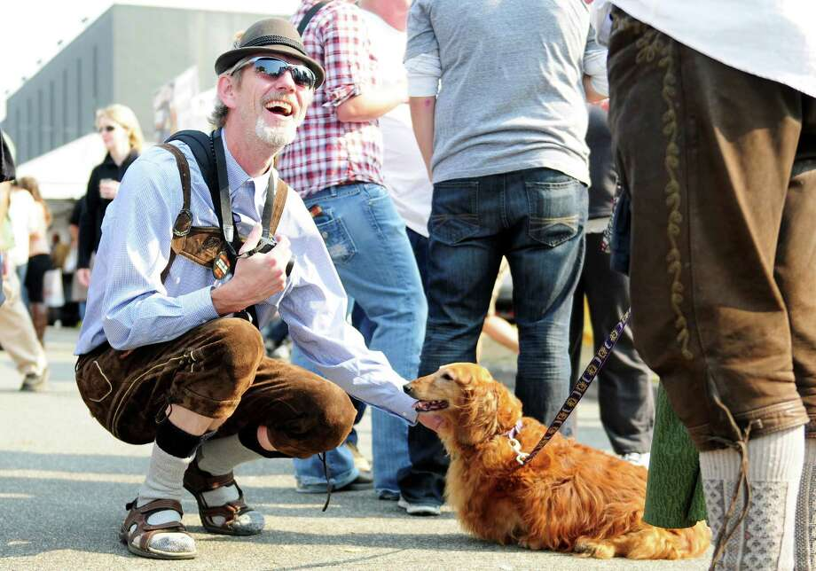 Chuck McGowan smiles as he pets another attendee's dachshund. Photo: LINDSEY WASSON / SEATTLEPI.COM