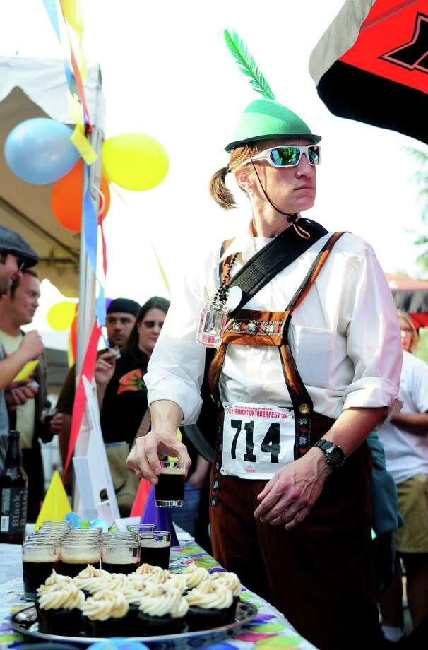 Shellie Matthews grabs a beer sample from Deschutes Brewery. Photo: LINDSEY WASSON / SEATTLEPI.COM