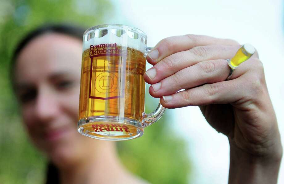 Nikki Jones displays her beer ring and sample. Photo: LINDSEY WASSON / SEATTLEPI.COM
