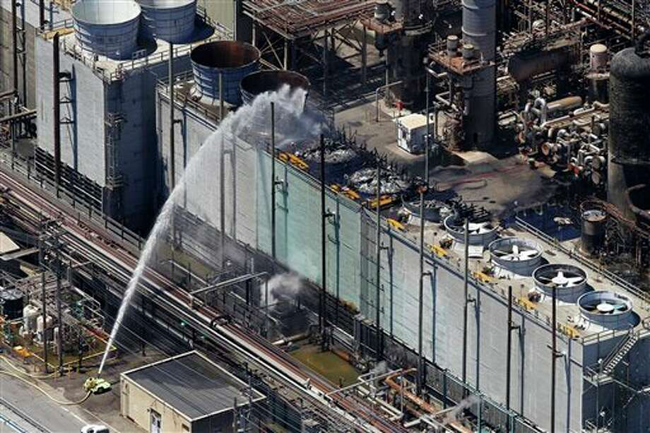 Firefighting crews continue to pour water onto a unit after a fire at a Chevron refinery on Tuesday, Aug. 7, 2012 in Richmond, Calif. The fire, which sent plumes of black smoke over the San Francisco Bay area, erupted Monday evening in the massive Chevron refinery about 10 miles (16 kilometers) northeast of San Francisco. It was out early Tuesday. Photo: Aric Crabb, AP / The Contra Costa Times