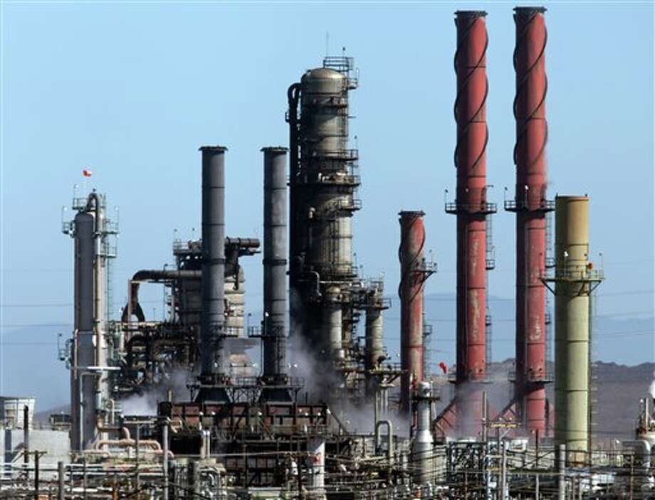 White smoke rises from the Chevron refinery during a controlled burn on Tuesday, Aug. 7, 2012, the morning after Monday's toxic fire in Richmond, Calif. An investigation into what caused the fire is ongoing. Heather Kulp, Chevron spokesperson, said the fire was caused by a vapor leak. Photo: Laura A. Oda, AP / Contra Costa Times