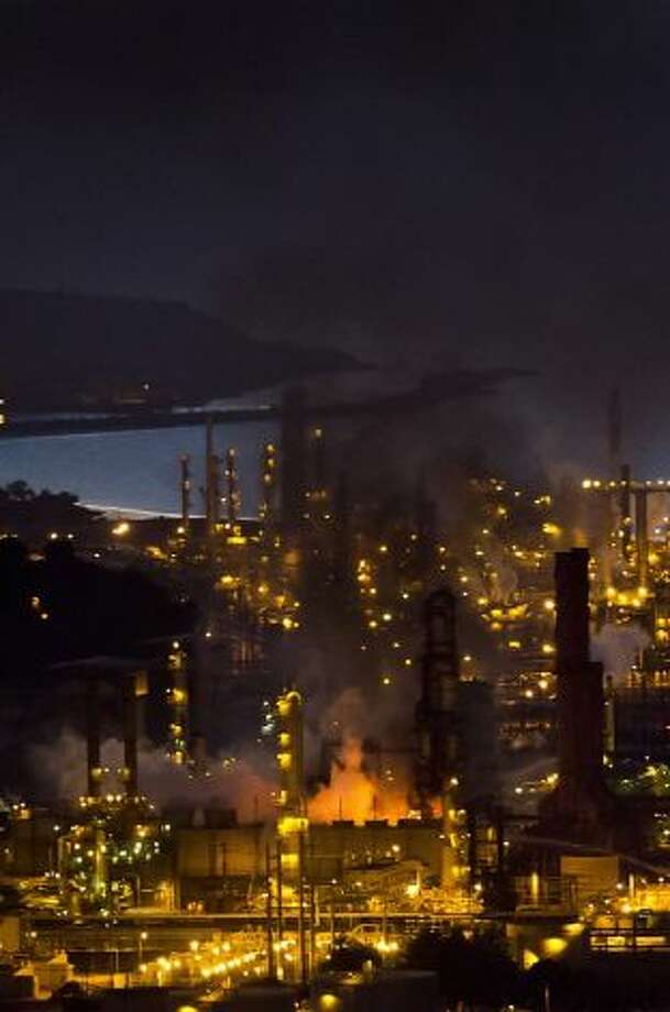 Flames and smoke shoot up from the Chevron refinery, a fixture in Richmond for more than a century. Photo: John Sebastian Russo, Special To The Chronicle / SF